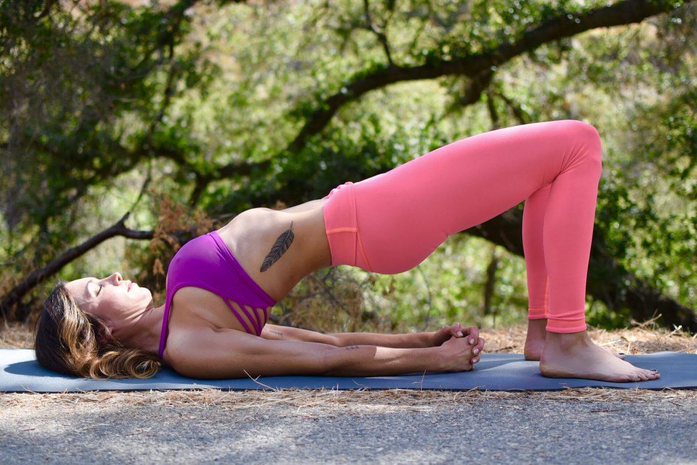 Mature woman doing yoga exercises stock photo